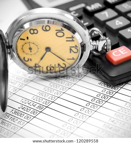 Watch, the calculator on documents. - stock photo