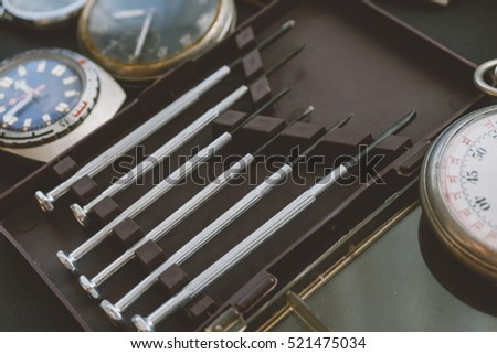 Watch tools and set old vintage wrist watches. collection wrist Soviet hours. Shallow focus and film effect