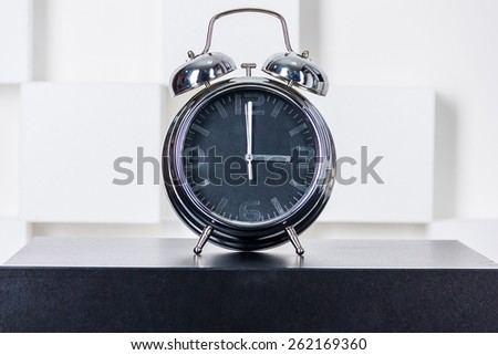 Watch with black dial are on the table - stock photo