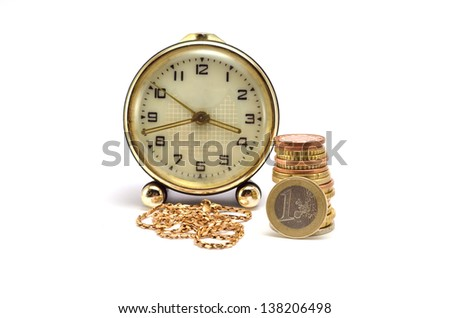 watches, gold chain and a lot of coins on a white a background