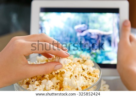 Watching a movie on digital tablet. - stock photo