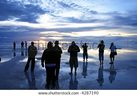 Watching a sunset over the bolivian saltflats - stock photo