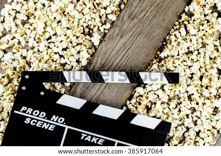 Watching movies with popcorn and snacks starts now - stock photo