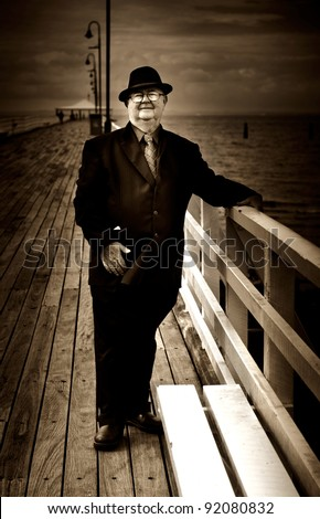 Watching On A Pier Platform A Ferryman Stands Awaiting To Take People Passing On A Journey To The Other Side - stock photo