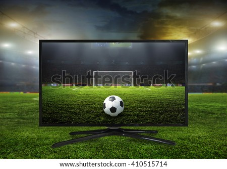 watching smart tv translation of football game. - stock photo