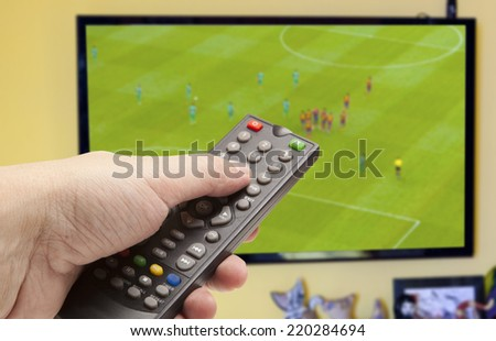 Watching soccer game on TV  - stock photo