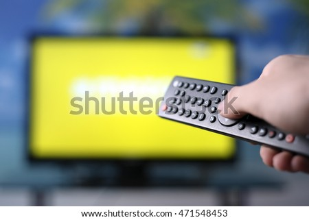 Watching TV and using remote controller