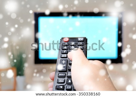 Watching TV and using remote controller over snow effect