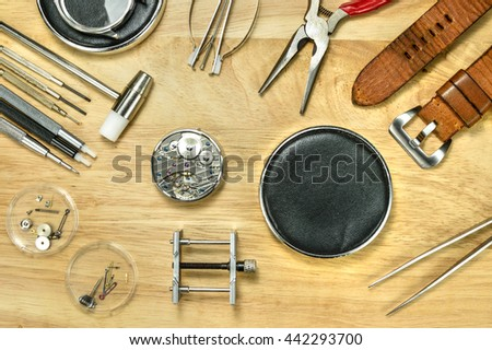 Watchmaker Tools and watch fix tools on wood table , Top view