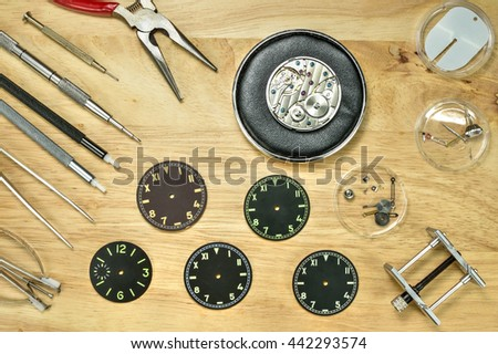 Watchmaker Tools and watch repair tools on wood table , Top view - stock photo