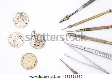 watchmaker tools isolated on white - stock photo
