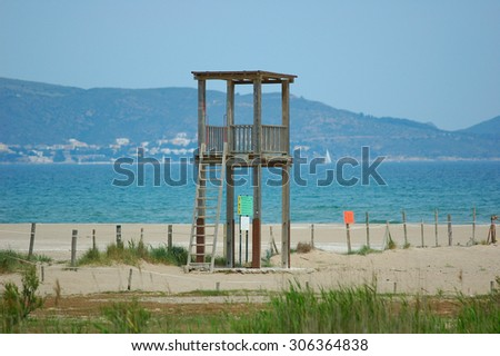 watchtower for a bather in a sandy beach  - stock photo