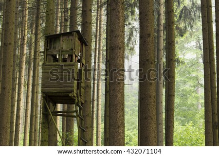 Watchtower for hunting, deep in the forrest. Concept: Hunting, abandoned, exploration. - stock photo