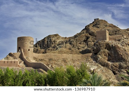 Watchtowers and defending walls and mountains in Old Muscat, Oman - stock photo