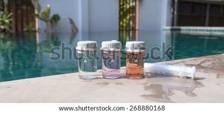 Water analysis tool at swimming pool - stock photo