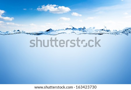 Water and air bubbles over sky background - stock photo