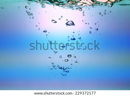 Water and air bubbles over white background. High resolution.