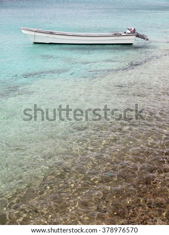 Water and boat at Bonaire island - stock photo