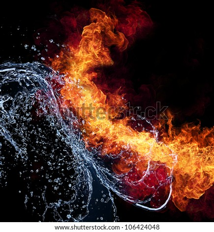 Water and fire connection, representation of elements. Isolated on black background - stock photo