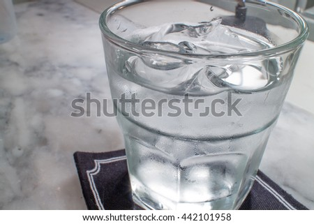 water and ice in the glass the dark room - stock photo