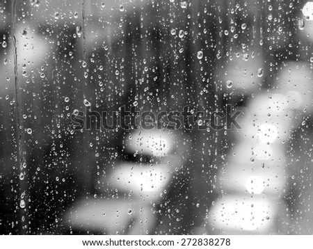 Water and rain drops on the glass, abstract view - stock photo