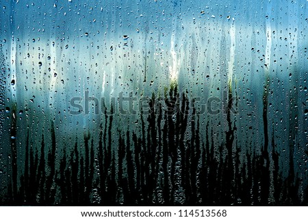 Water and rain drops on the glass, abstract view, Drops of rain on blue glass background / drops on glass after rain - stock photo
