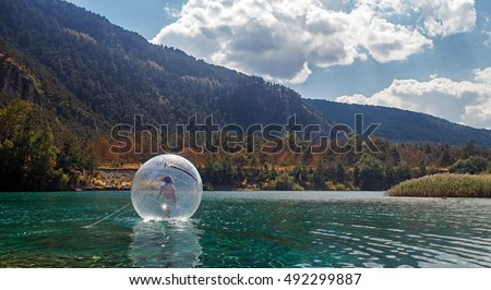 Water ball in Orfu Lake, close to Oulx, Italy