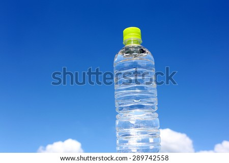 water bottle against a blue sky - stock photo