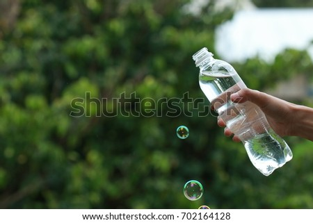 Water bottle in hand