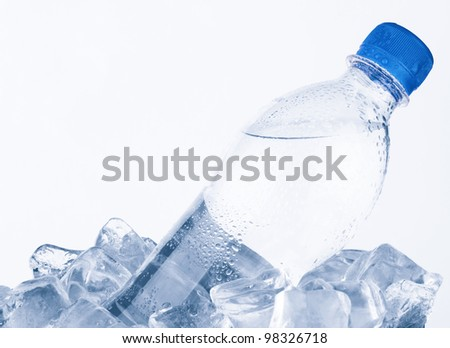 Water bottle in ice on white background - stock photo