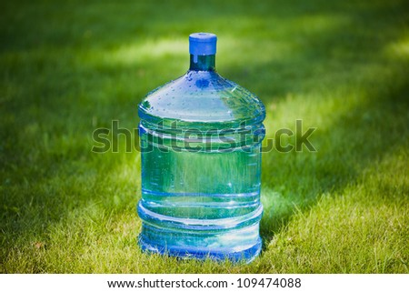water bottle on green grass background - stock photo