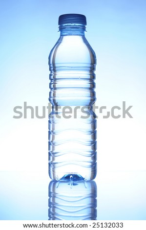 water bottle on the white-blue background with reflection - stock photo