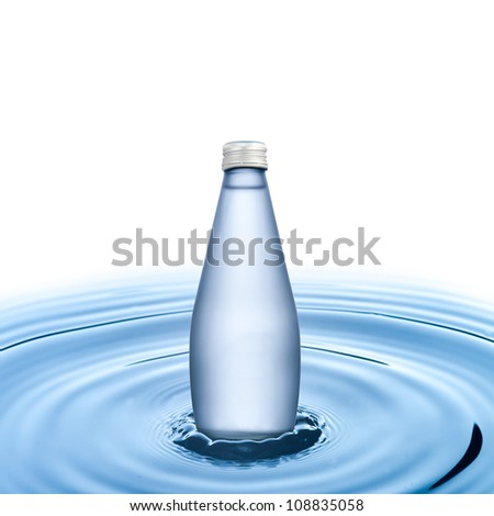 Water bottle on water wave on white background - stock photo