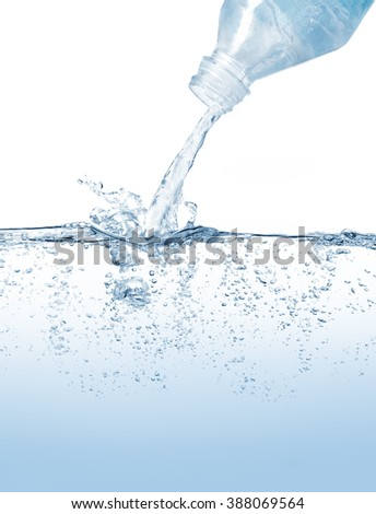 Water bottle pouring and splashing on water surface against blue background - stock photo