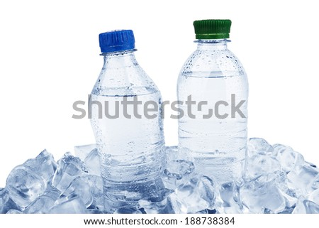 Water bottles in ice cube isolated on a white background  - stock photo