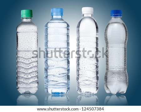 Water Bottles on blue background - stock photo
