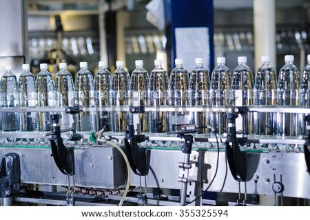 water bottles on production line - stock photo
