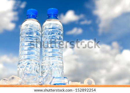 Water bottles with blue sky - stock photo