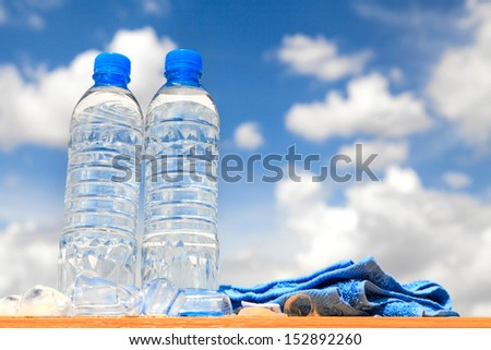 Water bottles with blue sky