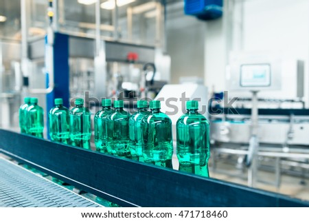 Water bottling line for processing and bottling pure mineral carbonated water into bottles. Selective focus.