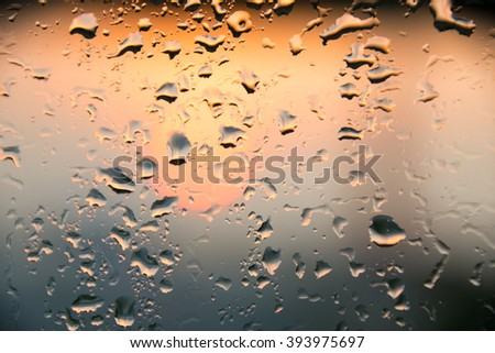 water bubble drop, raindrop on glass and dripping down
