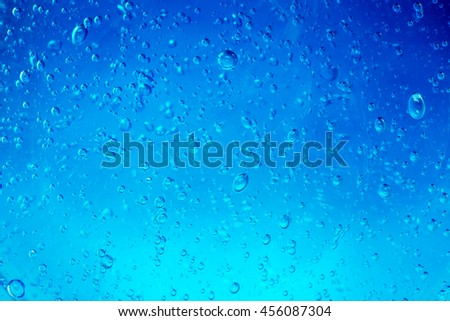 water bubbles flowing in a blue background - stock photo