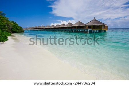 Water bungalows close to the shore, Maldives - stock photo