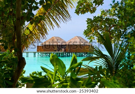 Water bungalows on a tropical island, vacation background