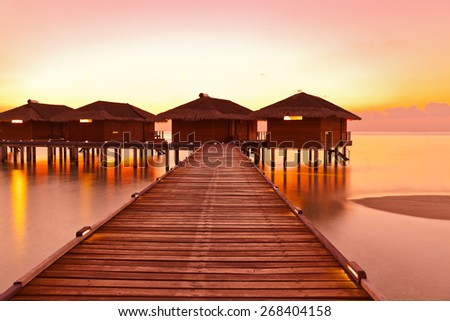 Water bungalows on Maldives island - nature travel background - stock photo