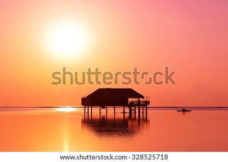 Water bungalows on Maldives island - nature travel background - stock photo