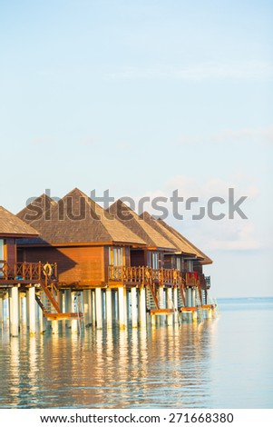 Water bungalows with turquiose water on Maldives - stock photo