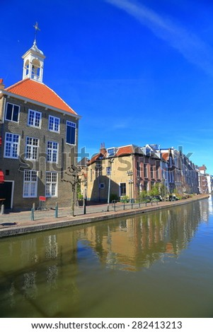 Water canal and traditional buildings in the old town of Schiedam, Holland