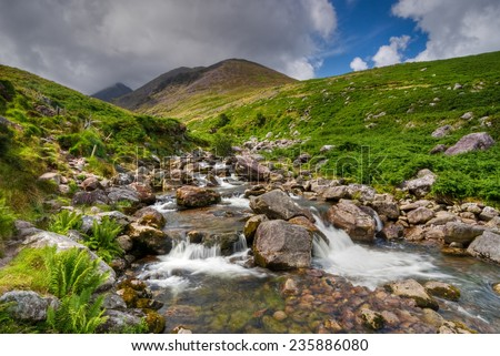 Water cascade in wild hills of Ring Of Kerry, Ireland, Europe - stock photo