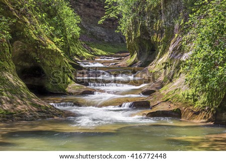 Water cascades down The Potholes at Fall Creek Gorge Preserve in Warren County, Indiana.